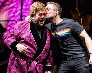 Watch: Surprise Duet From Elton John &